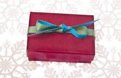 Festive Holiday Gift Box on Snowflakes Stock Photos