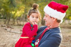 Festive Holiday Grandfather and Mixed Race Baby Girl. Festive Grandfather and Mixed Race Baby Girl Outdoors stock image