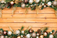 Festive holiday ornament and pine garland border. A cedar panel background Royalty Free Stock Photo