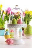 Festive holiday table with fresh flowers and Easter eggs stock image