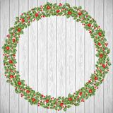 Festive Holiday wreath on a rustic wooden background. EPS 10 vector Stock Images