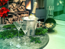 Festive home decoration with champagne and fireplace Royalty Free Stock Image
