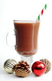 Festive Hot Chocolate. Mug of hot chocolate with candy cane and christmas ornaments Royalty Free Stock Photos