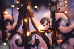 Festive illumination on the fence in the evening winter time, ab. Stract Christmas New Year beautiful festive winter background and texture royalty free stock image