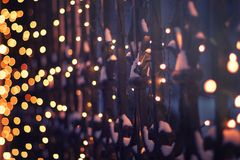 Festive illumination on the fence in the evening winter time, ab. Stract Christmas New Year beautiful festive winter background and texture royalty free stock photography