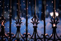 Festive illumination on the fence in the evening winter time, ab. Stract Christmas New Year beautiful festive winter background and texture royalty free stock photo