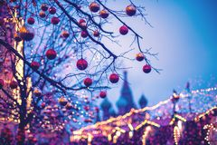 Festive illuminations in the streets of the city. Christmas in Moscow, Russia. Red Square. View to St. Basil cathedr royalty free stock photography