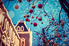 Festive illuminations in the streets of the city. Christmas in Moscow, Russia. Red Square. View to illuminated GUM. Little snow in background royalty free stock image