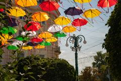 Festive installation - alley of umbrellas on the street of the city royalty free stock photography