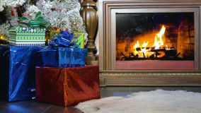 Christmas presents beside a burning fireplace. Christmas background. stock video footage