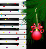 Festive keys and red ball. Dark background, abstract large music keys, confetti and the green branch of the big tree with the red decorative ball Royalty Free Stock Photos