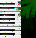 Festive keys and tree. Dark background, abstract large music keys, confetti and the green branch of the big tree Royalty Free Stock Photography