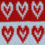 Festive knitted background with red  hearts Royalty Free Stock Photos