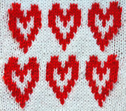 Festive knitted background with red  hearts Stock Images