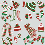 Festive knitwear. Vector image of the various striped knitted clothes Stock Photo