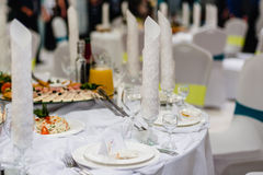Festive laid table in the restaurant with glasses and plates Stock Photo