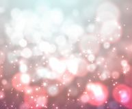Festive light background with bokeh and stars Royalty Free Stock Photography