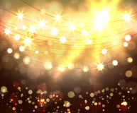 Festive light background with bokeh and stars Royalty Free Stock Photos
