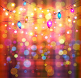 Festive light background with bokeh and stars. Vector Royalty Free Stock Image