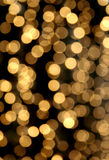 Festive light chain blur. Festive light chain color spots in dark background stock photography