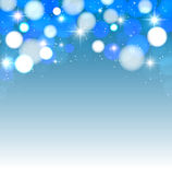 Festive lights on a blue background. Abstract background with glow Stock Images