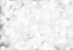 Festive lights at night. White Blurred festive lights at night Stock Images