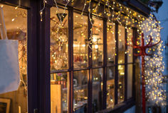 Festive lights outside a shop window Royalty Free Stock Photos