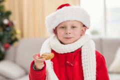 Festive little boy eating a cookie Stock Photography