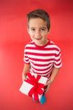 Festive little boy holding a gift Stock Photo