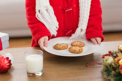 Festive little boy holding plate of cookies Royalty Free Stock Photos