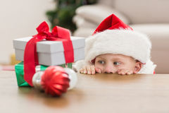 Festive little boy looking at gifts Stock Photo