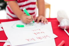 Festive little boy writing wish list Royalty Free Stock Photography