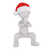 Festive little Christmas 3d man praying. Festive little Christmas 3d man in a Santa hat praying with his hands clasped in a crouched position, isolated 3d Stock Images