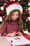 Festive little girl drawing pictures Royalty Free Stock Photo