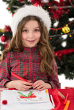 Festive little girl drawing pictures Stock Photos