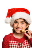 Festive little girl eating cookie Stock Photography