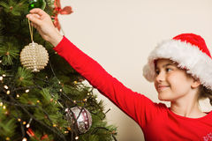 Festive little girl hanging a christmas decoration Stock Photography