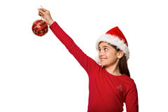 Festive little girl hanging a christmas decoration Royalty Free Stock Photography