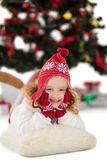 Festive little girl in hat and scarf Royalty Free Stock Photography