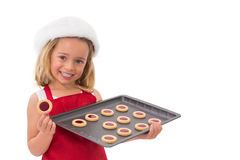 Festive little girl holding fresh cookies Stock Image