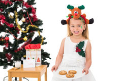 Festive little girl holding fresh cookies Royalty Free Stock Photos