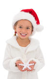 Festive little girl holding snowflake Stock Image