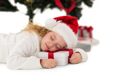Festive little girl napping on a gift Stock Photo
