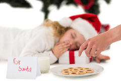 Festive little girl napping on a gift Royalty Free Stock Photo
