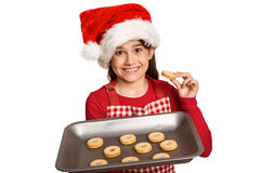 Festive little girl offering cookies Royalty Free Stock Photos