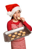 Festive little girl offering cookies Royalty Free Stock Image