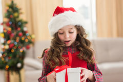 Festive little girl opening a gift Royalty Free Stock Photo
