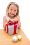 Festive little girl opening a gift Royalty Free Stock Images