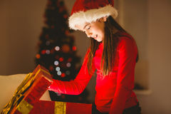 Festive little girl opening a glowing christmas gift Royalty Free Stock Photography