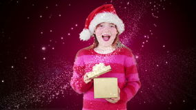 Festive little girl opening magical christmas gift stock video
